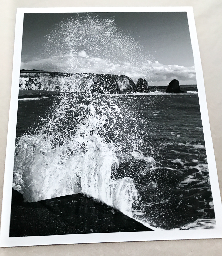 black and white photo print of large wave